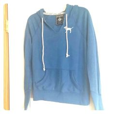 VS PINK blue hoodie! Adorable, preloved PINK by VS blue hoodie for sale! Features V neck with dog on the front, and star with Pink on the back. White drawstrings to adjust hood. Very cute and comfortable. Bundle for great savings today! PINK Victoria's Secret Tops Sweatshirts & Hoodies