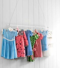 display rack for vintage children's dresses