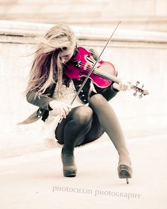 Girl playing pink violin repinned by Morgan Malott