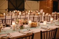 At Last Wedding + Event Design. Sometimes all you need i simple floral + candlelight. Photo by studio222 photography