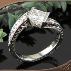 Gorgeous engraving on this twist engagement ring.