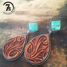 Tooled leather and tuquoise earrings Teardrop detailed hand tooled leather Solid sterling silver trim and back Soldered stud trim edge detail Real turquoise dia