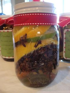 the scent of Christmas in a jar!   1 pint jar  3 cinnamon sticks  3 bay leafs  2-3 Tbs. whole cloves {these will cost you the most}  1 lime slice  2 lemon wedges  2 orange slices