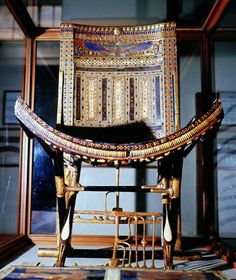 Ceremonial Chair of Tutankhamun Openwork motif of the 'Union of the Two Lands' or Sema Tawy, ebony inlaid with faience, ivory and glass, from the Tomb of Tutankhamun Valley of the Kings, West. Egyptian Pharaohs, Ancient Egyptian Art, Egypt Museum, Long Pearl Necklaces, Gold Necklace, Valley Of The Kings, Gold Jewellery Design, Gold Jewelry, Bridal Jewelry
