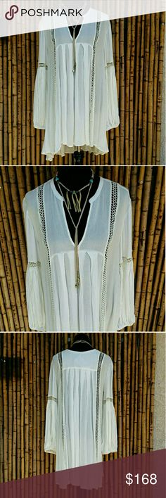 "FREE PEOPLE Just The Two of Us Tunic NWT! FREE PEOPLE Just The Two of Us Tunic NWT! PRICE IS FIRM. This baby doll style tunic has long bubble sleeves, elastic at wrists, lace insets, semi sheer fabric, ivory color, 100% rayon, length 32"" front 37"" back, pit2pit lay flat is 23"" across front, V-neck and pullover. I paid retail for this, I just never wore it! It is brand new and difficult to find any more. Isnt it just gorgeous!  X No Trades  $ PRICE IS FIRM  ? Please Ask ?'s BEFORE you Buy…"
