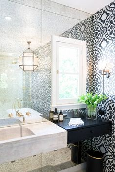 Superb This bathroom was designed to look antiqued, but with a refined classic and unique vibe. With custom antique mirror panels, Cement Tile Shop tiles on the walls, an antique sink, a Restor . Bathroom Design Inspiration, Bad Inspiration, Bathroom Interior, Bathroom Ideas, White Bathroom, Bathroom Makeovers, Bathroom Updates, Bathroom Mirrors, Wall Mirrors