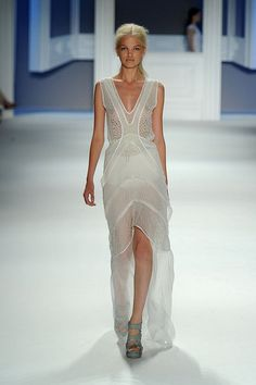 Vera Wang Spring 2012 RTW.  I like the X shaped layer over the simple top, and the levels of translucency, too.  Don't know about the hemline.