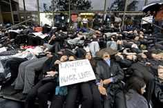 "Lawyers, law students, legal staff and victims of police brutality participate in a ""die-In"" during a protest in front of the Stanley Mosk Courthouse in Los Angeles, California December 16, 2014. REUTERS/Kevork Djansezian"
