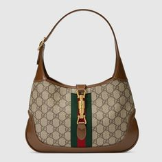 Shop the Jackie 1961 small hobo bag in beige at GUCCI.COM. Enjoy Free Shipping and Complimentary Gift Wrapping.