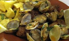 Portugal's Best Eats - via Corks, Forks and Travel Nov. 2015 | The regional classics and everyday meals that make Portugal a foodie heaven. So much stands out, but in my experiences, these are the regional classics and everday dishes you've got to try. Photo: Carne de porco a Alentejana