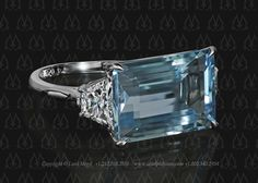 Blue aquamarine engagement ring by Leon Mege