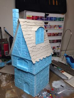 Fantasy building built using floor insulation foam board, cut and scored with details. Additional card roof tiles.  By Rich Goss