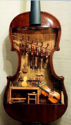 This 18th-century violin makers shop by W. Foster Tracy, 1979, is a miniature built inside a full-size violin. It was on display at the Mini Time Machine Museum of Miniatures, Tucson, Arizona. All completed instruments and tools are fully functional in this model.