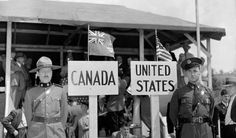 """A Royal Canadian Mounted Police officer stands in front of a sign marked """"Canada,"""" beside an American state trooper. Canada States, O Canada, United States, Commonwealth, Canadian History, American History, Losing Faith, Wwii, Historia"""