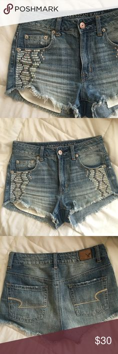 American Eagle Festival shorts Like new condition only worn once American Eagle Hi-Rise festival shorts size 0 light/medium wash.    PLEASE CHECK LAST PICTURE FOR MEASUREMENTS.   CANT MODEL SORRY!    Same/next day shipping American Eagle Outfitters Shorts Jean Shorts