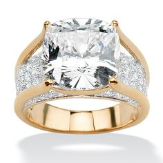 <li>Cushion-Cut and Round cubic zirconia engagement ring</li><li>Goldplated jewelry</li><li><a href='http://www.overstock.com/downloads/pdf/2010_RingSizing.pdf'><span class='links'>Click here for ring sizing guide</span></a></li>