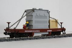 This flat car was built to carry the battery box for my Power Functions base PRR The battery box is hidden in the electrical transformer load. Lego Train Station, Lego Train Tracks, Lego Trains, Lego Plane, Lego Boat, Lego Ship, Lego Mechs, Lego Modular, All Lego