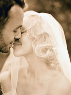 Look at those classy curls. And the kiss through the veil. Love it.