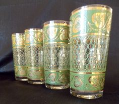 Thisset+offour+highball+tumbler+glasses+are+made+by+Culverduring+the+1950s-1960s.+The+clear+glassfeatures+a+green+latticepanel+that+circles+around+the+middle+of+the+glass.Thereis+asmall+gold+spadecentered+in+each+open+s...