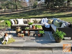A backyard patio living room with Hampton Bay Beverly Sectional with additional seats, outdoor rug and potted plants Outdoor Couch, Outdoor Rooms, Outdoor Living, Outdoor Furniture Sets, Outdoor Decor, Backyard Patio, Backyard Landscaping, Flagstone Patio, Backyard Ideas