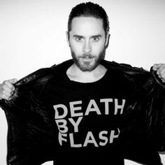 "Super comfy, unisex t-shirt made by Cotton Citizen features ""DEATH BY FLASH"" on front with Jared's logo on back. 100% Cotton. Fits true to size. Made in USA. Machine Wash Cold, Tumble Dry Low. Do not bleach.     Photo by Terry Richardson."