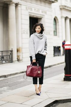 Shini Park from Park and Cube wearing a Michael Kors Tote. London, October 2013