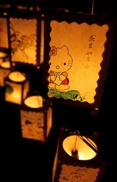Kitty-chan and Japanese lanterns on display at a summer festival. Japan, Toyama