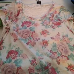 Floral top Beautiful pink floral front and lace back top. New with tags. So very pretty, light weight rue21. Tops Tees - Short Sleeve