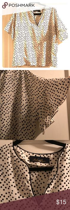 Francesca's white blouse with black polka dots Size M Francesca's (Blue Rain brand) blouse. White with black polka dots. Made for a short torso, never worn due to it being too short on me. Arms have a cute ruffle to them. Slight v neck. Francesca's Collections Tops Blouses