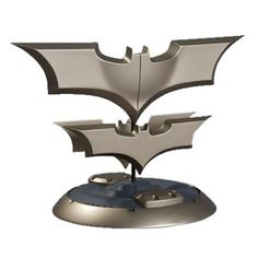 Batman Batarang. I would totally buy this for Jason to have in his game room!