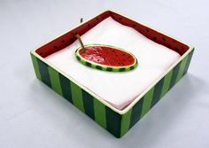 Watermelon Napkin Holder, using our Napkin Holder #5124 and Large Oval Bisquie #8183 as a napkin weight.
