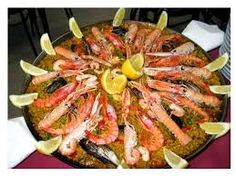 MasterCheff: Spanish PaellaIngredients  2 1/2 cups rice 5 boneless chicken breasts 10 Shrimp 350 gms of Squids cut as rings All purpose flour for dusting 100 g chorizo, sliced 6 slices pancetta (streaky bacon) 1 finely chopped onion
