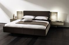 contemporary double bed with integrated bed-side table CUTARO hülsta