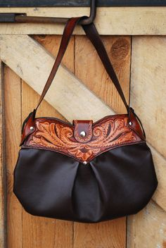 Hey, I found this really awesome Etsy listing at http://www.etsy.com/listing/129290434/country-western-leather-tooled-purse