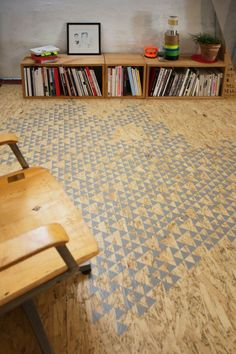 Very creative use of OSB here. Unique stenciling gives out a new-age effect to the economic & durable OSB. We love OSB & use it in all of our structures. Painted Osb, Painted Plywood Floors, Wooden Flooring, Laminate Flooring, Osb Plywood, Cnc Wood, Wood Wood, Floor Design, House Design