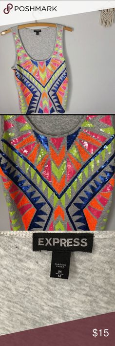 Express Sequin Tank Express tank with neon sequin tribal design. This tank top will definitely steal the show! It's bold colors are perfect for spring and summer! Size medium. Express Tops Tank Tops