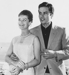 """Romy Schneider & Alain Delon - The two of the biggest international screen actors—Delon was apparently called the """"male Brigitte Bardot""""—met in 1958 and became engaged. The pair made six films together before they ended their engagement in Romy Schneider, Michelangelo Antonioni, Claudia Cardinale, Alain Delon, Sophia Loren, Samuel Beckett, Gilles Caron, Funeral, Movies"""
