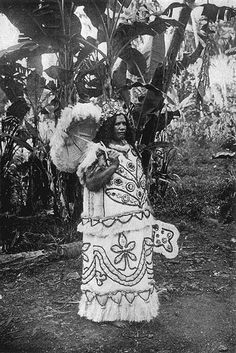 Marquesas Island Chiefess in a traditional tapa cloth costume.