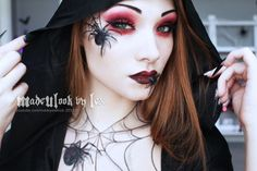 WOW! That is so amazing, I cant believe those spiders were made from eyeliner and eye shadow! I will never be able to do that but man it's cool!! :)