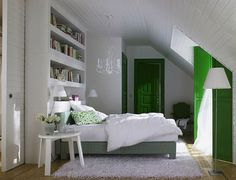 Energetic Kelly Green  provides weight, grounding and focus when paired with a white palette in this attic bedroom.  Rather than being too stimulating, the cheerful green and white has a sunny, yet calming and serene appeal, while offering the feeling of being spacious and organized.