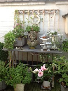 Love the display of garden statue and containers just waiting to inspire!