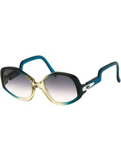 Translucent blue and green butterfly frame sunglasses from Christian Dior Vintage featuring gradient lenses, silver-tone hinge detailing and curved arms.