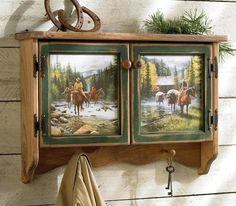 Cowboy Wall Shelf A Black Forest Decor Exclusive Made of pine, the Cowboy Wall Shelf is graced with a horse scene on the door panels and includes two pegs for hanging. Cowboy Home Decor, Western Bedroom Decor, Western Bedrooms, Rustic Bedrooms, Wall Shelf Decor, Wall Shelves, Western Furniture, Rustic Furniture, Cabin Furniture