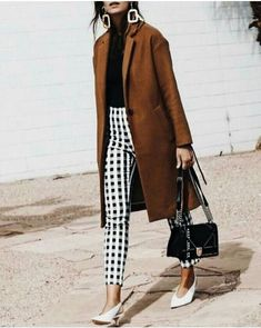 camel coat and printed pants