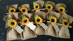 Sunflower seed packets wedding favors. Super adorable. Wrapped in burlap bags with a ribbon and silk sunflower tying it all up!