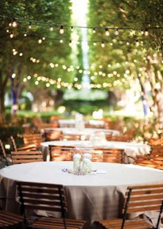 Strings of lights create a romantic ambience. Lighting by Beyond Lighting. Photo by Lauren Larsen. #wedding #lighting