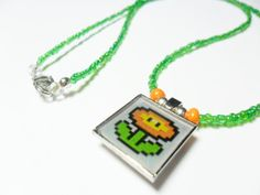 Mario fire flower necklace video game nintendo by ReturnersHideout, $12.50  https://www.etsy.com/listing/167297731/mario-fire-flower-necklace-video-game