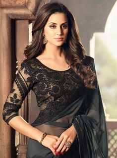 25 Latest Black Saree Blouse Designs Black is a color that looks very interesting, classy and one can never go wrong in a black outfit. In fact, black also makes you look slim and hide the flabs. We've compiled the list of the beautif… Black Blouse Designs, Saree Jacket Designs, Sari Blouse Designs, Modern Blouse Designs, Black Saree Blouse, Lace Saree, Saree Dress, Silk Sarees, Grey Saree
