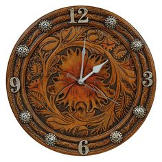 .  Leather tooled flower clock