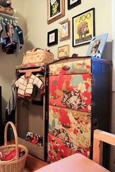 Do over: re-upholstered vintage steamer trunk, now used for kids clothes.